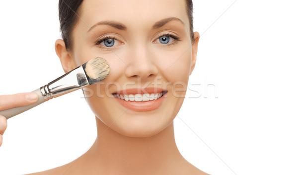 woman applying liquid foundation with brush Stock photo © dolgachov