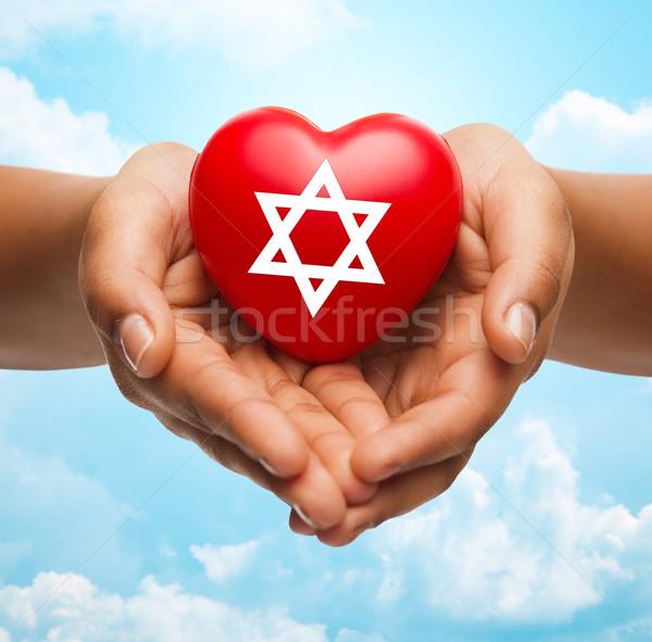 Mains coeur star religion Photo stock © dolgachov