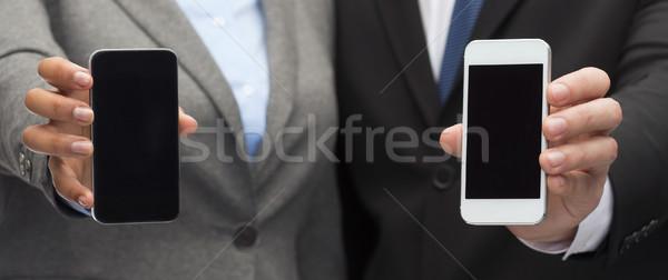 Stok fotoğraf: Işadamı · işkadını · akıllı · telefonlar · iş · teknoloji · siyah
