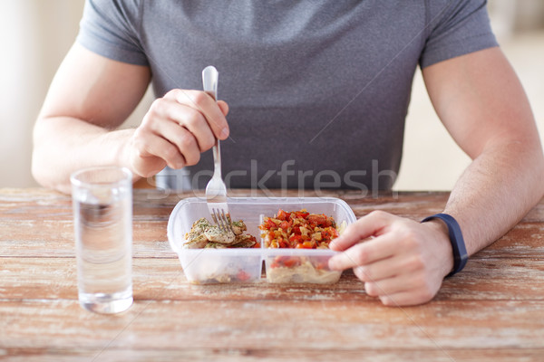 close up of man with fork and water eating food Stock photo © dolgachov