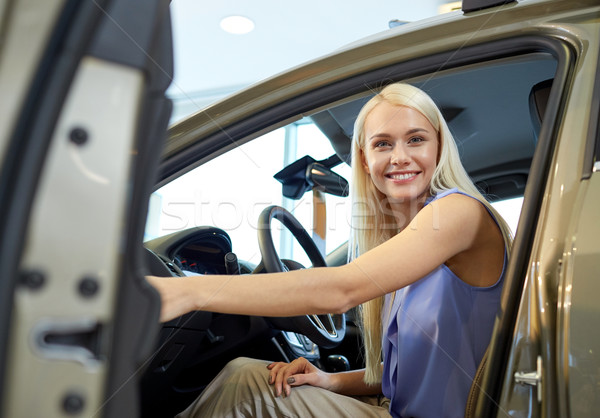 happy woman inside car in auto show or salon Stock photo © dolgachov