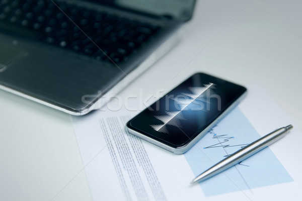 close up of smartphone, laptop and pen on table Stock photo © dolgachov
