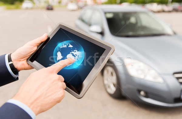 close up of male hands with tablet pc and car Stock photo © dolgachov