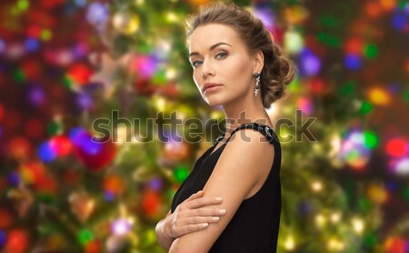 beautiful sexy woman in red dress over lights Stock photo © dolgachov