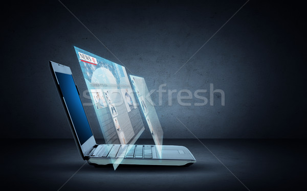 laptop computer with news web page projection Stock photo © dolgachov