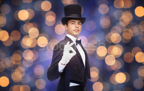 magician in top hat showing ok hand sign Stock photo © dolgachov