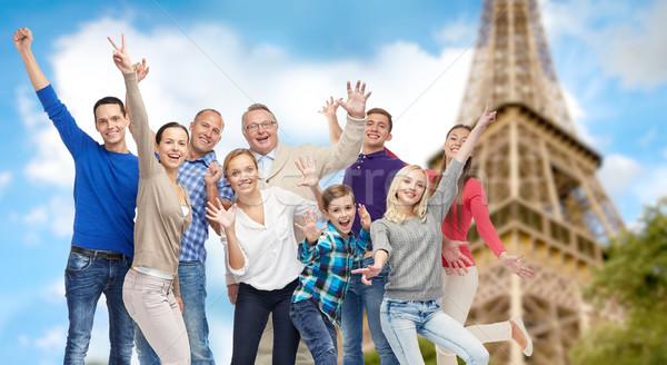 Grupy szczęśliwych ludzi Wieża Eiffla rodziny podróży Zdjęcia stock © dolgachov