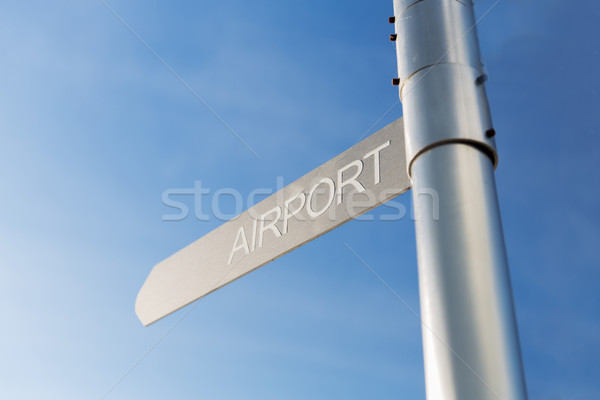 close up of airport signpost over blue sky Stock photo © dolgachov