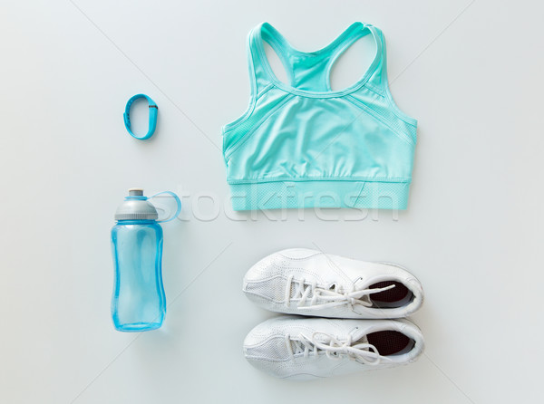 close up of sportswear, bracelet and bottle Stock photo © dolgachov