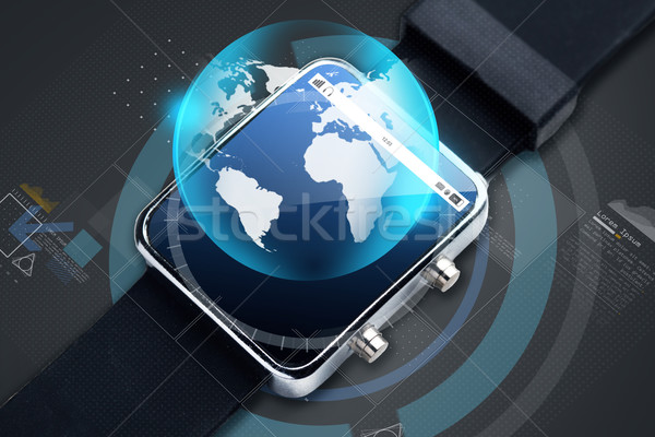 close up of smart watch with earth globe hologram Stock photo © dolgachov