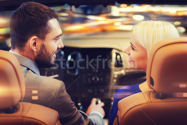 happy couple driving in car over night city  Stock photo © dolgachov