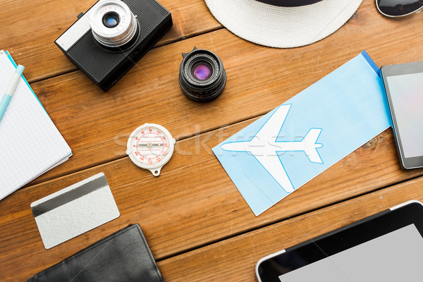 close up of camera and traveler personal stuff Stock photo © dolgachov