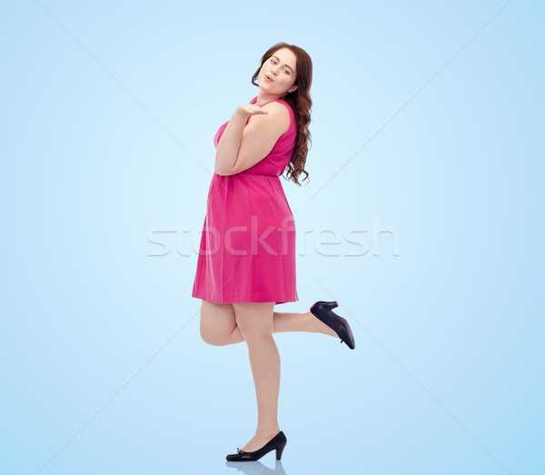 happy young plus size woman and sending blow kiss Stock photo © dolgachov
