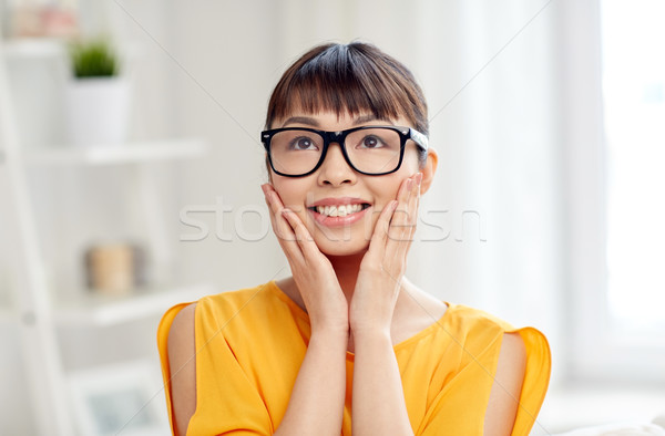 Stock photo: happy asian young woman in glasses at home