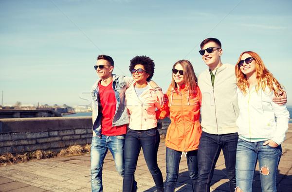 счастливым друзей ходьбе городской улице туризма Сток-фото © dolgachov