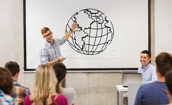 group of students and teacher at white board Stock photo © dolgachov