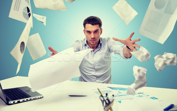 Stock photo: angry businessman throwing papers in office