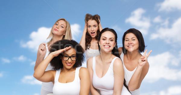 Csoport boldog nők fehér alsónemű szórakozás Stock fotó © dolgachov