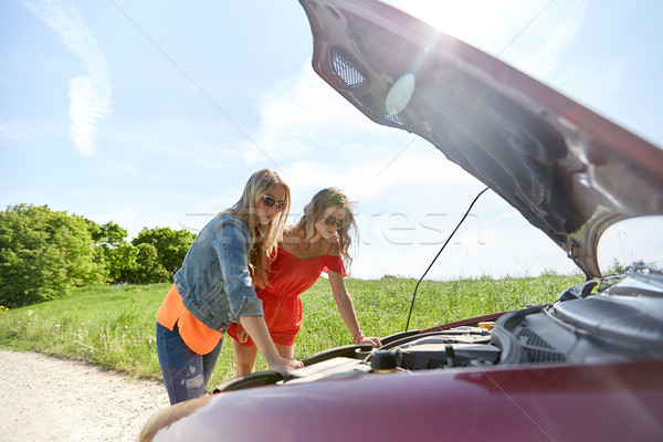 women with open hood of broken car at countryside Stock photo © dolgachov
