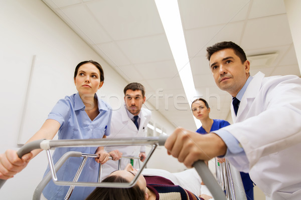 medics with woman on hospital gurney at emergency Stock photo © dolgachov