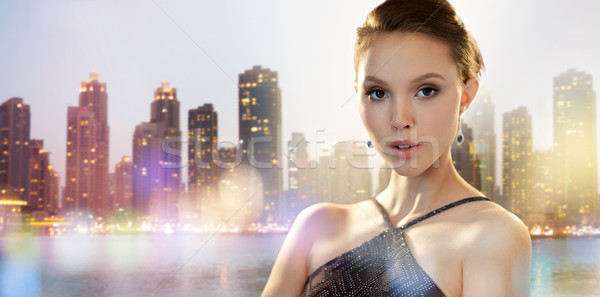 beautiful young asian woman with earring in city Stock photo © dolgachov