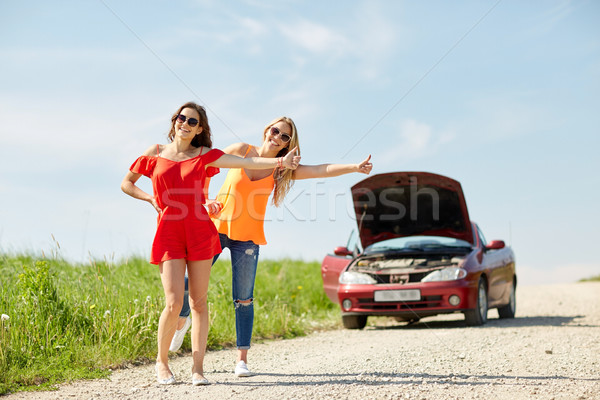 women with broken car hitchhiking at countryside Stock photo © dolgachov