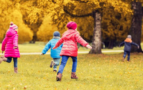 group of happy little kids running outdoors Stock photo © dolgachov