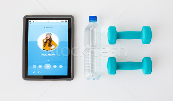 close up of tablet pc, dumbbells and water bottle Stock photo © dolgachov