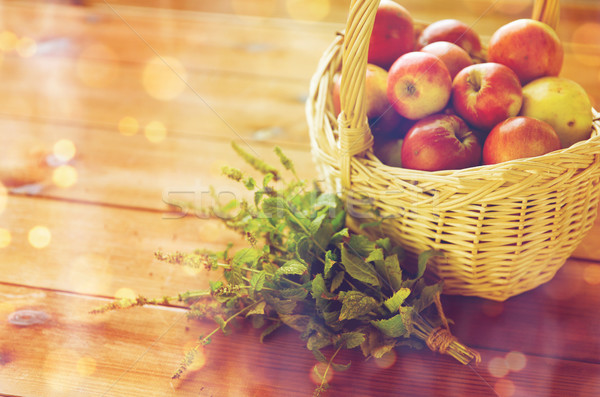 close up of melissa and basket with apples Stock photo © dolgachov