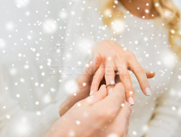 close up of man giving diamond ring to woman Stock photo © dolgachov
