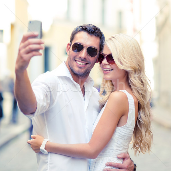 smiling couple taking selfie with smartphone Stock photo © dolgachov