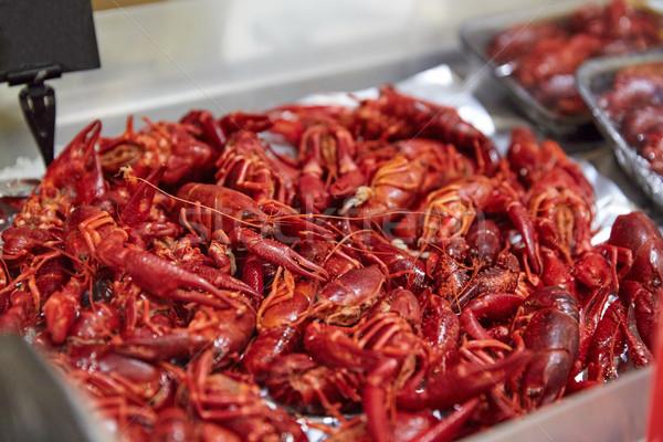 boiled red crayfish at street market Stock photo © dolgachov