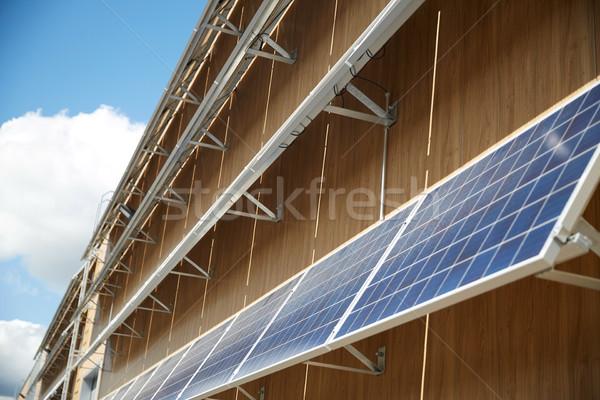 Solaire batterie bâtiment façade énergie pouvoir Photo stock © dolgachov