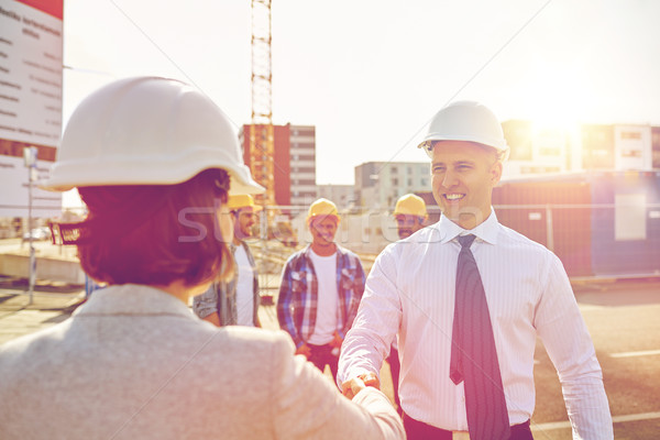 builders making handshake on construction site Stock photo © dolgachov