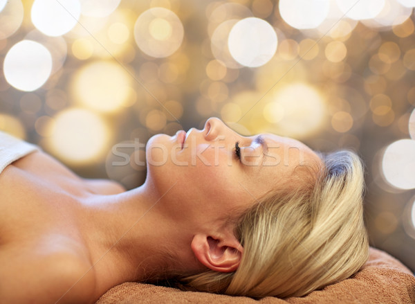 close up of young woman lying in spa Stock photo © dolgachov