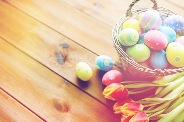 Huevos de Pascua cesta flores Pascua vacaciones Foto stock © dolgachov