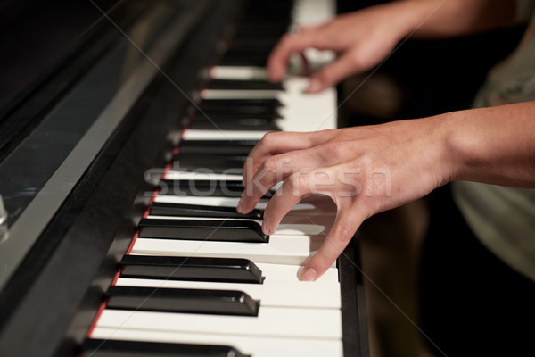 close up of hands playing piano Stock photo © dolgachov