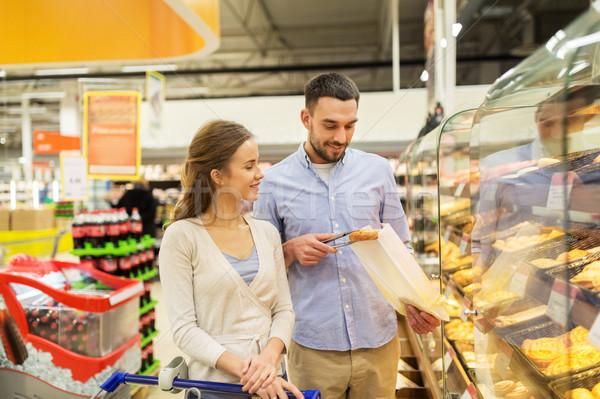 Boldog pár bevásárlókocsi élelmiszerbolt étel vásár Stock fotó © dolgachov