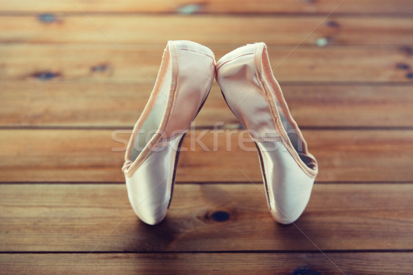 close up of pointe shoes on wooden floor Stock photo © dolgachov