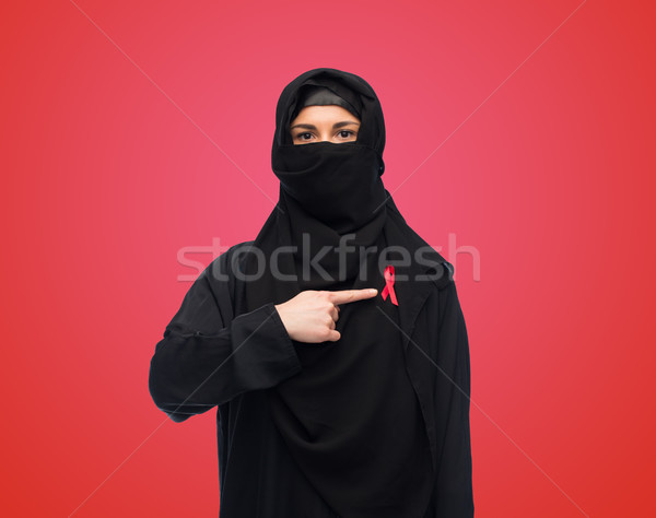 muslim woman in hijab with red awareness ribbon Stock photo © dolgachov