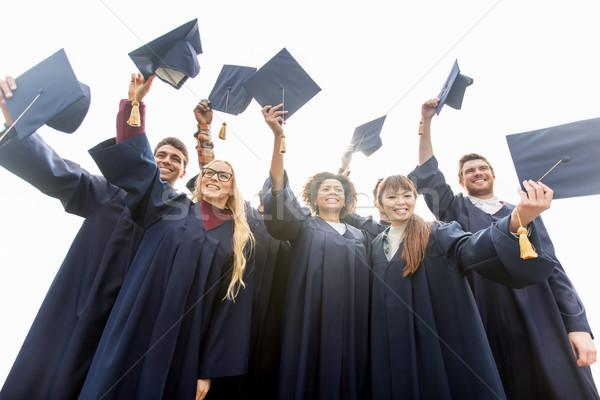 Gelukkig studenten bachelors onderwijs afstuderen Stockfoto © dolgachov