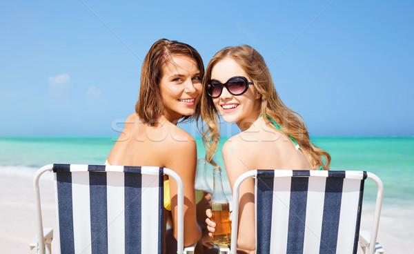 Сток-фото: счастливым · напитки · солнечные · ванны · пляж · лет