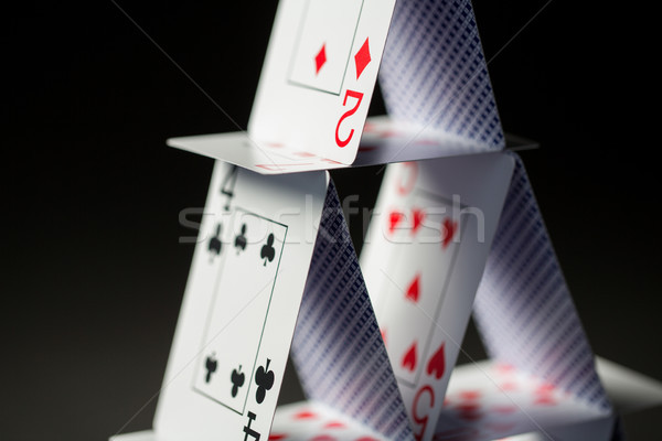 close up of house of playing cards over black Stock photo © dolgachov