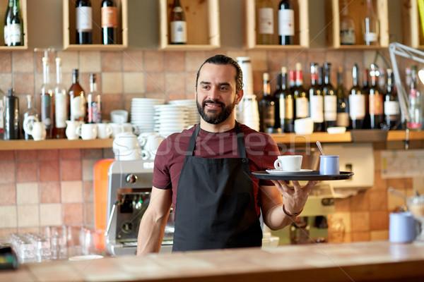 Szczęśliwy człowiek kelner kawy cukru bar Zdjęcia stock © dolgachov