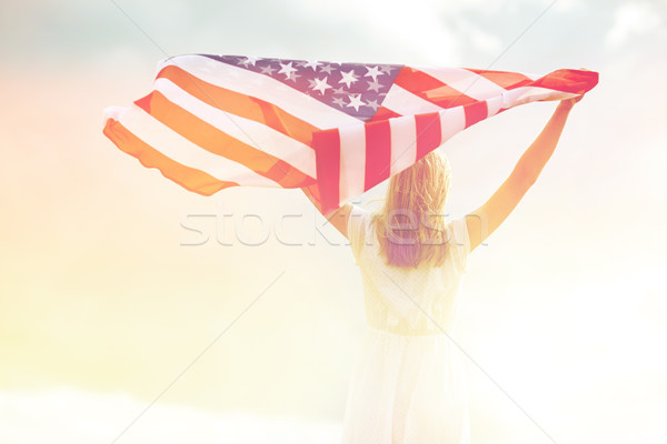happy young woman with american flag outdoors Stock photo © dolgachov