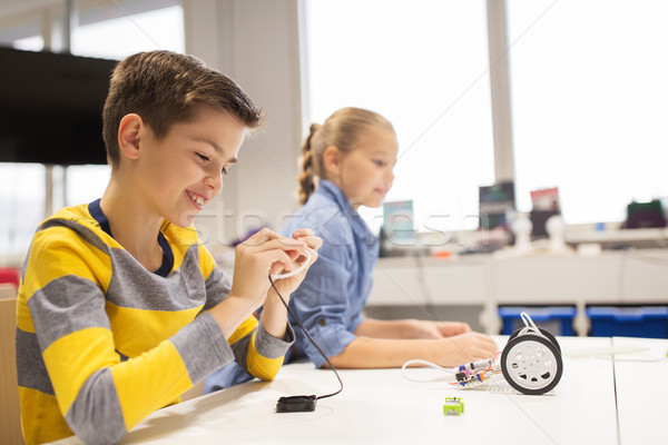 happy children building robots at robotics school Stock photo © dolgachov