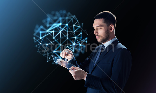 businessman with tablet pc and network projection Stock photo © dolgachov