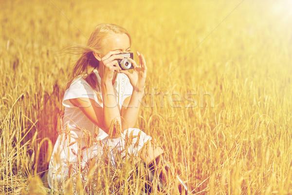 женщину фотография камеры зерновых области Сток-фото © dolgachov