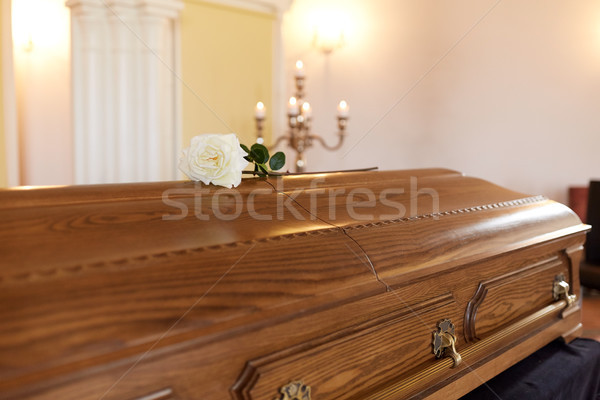 rose flower on wooden coffin at funeral in church Stock photo © dolgachov