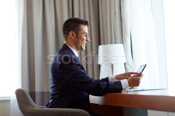 бизнесмен рабочих номер в отеле деловые люди технологий Сток-фото © dolgachov